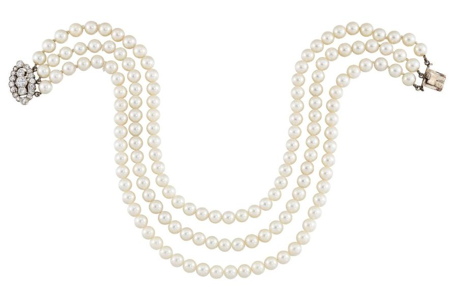 A cultured pearl choker necklace, composed as a triple row of cultured pearls to…