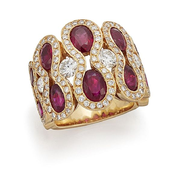 A French, ruby and diamond dress ring, the front composed of a series of graduat…