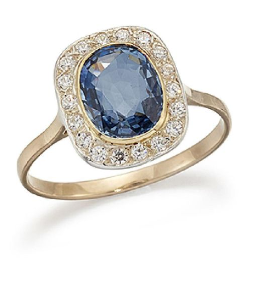 A sapphire and diamond cluster ring, the oval sapphire single stone in collet se…