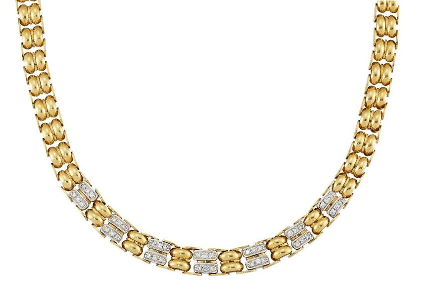 A diamond set necklace, of twin bar link design, the front alternately set with …