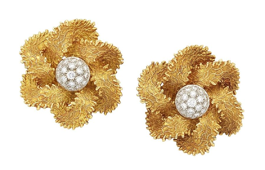 A pair of French, diamond earrings, each designed as a flower head with pavé dia…