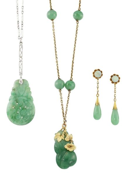 Two jade pendent necklaces and a pair of opal and jade earrings, the first neckl…