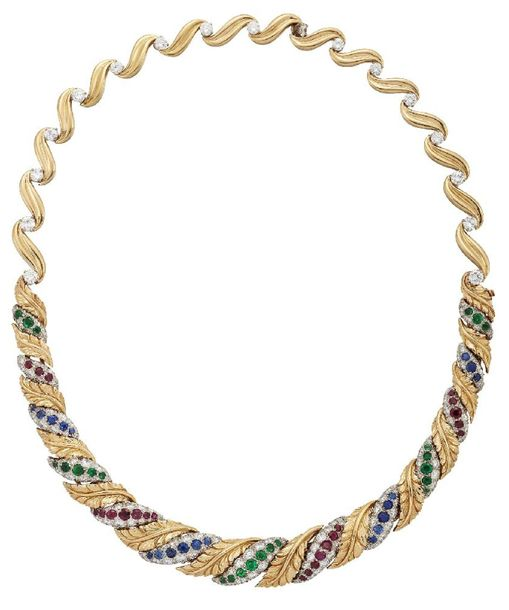 A diamond and gem set necklace, the front composed of a series of graduated, sha…