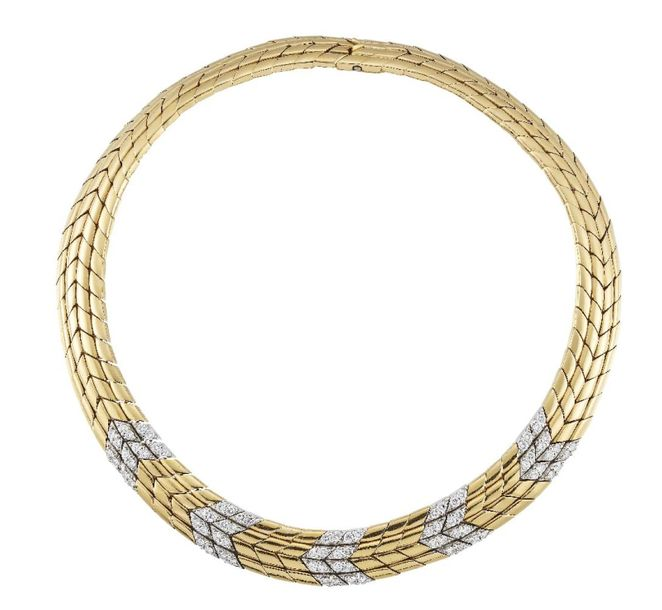 A two colour gold and diamond chevron link collar necklace, composed as a series…