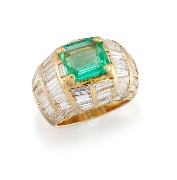 An emerald and diamond ring, the cut cornered rectangular emerald to a baguette …