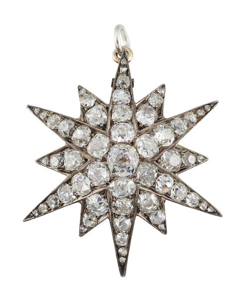 A Victorian diamond star brooch/pendant, designed as a twelve pointed star set t…