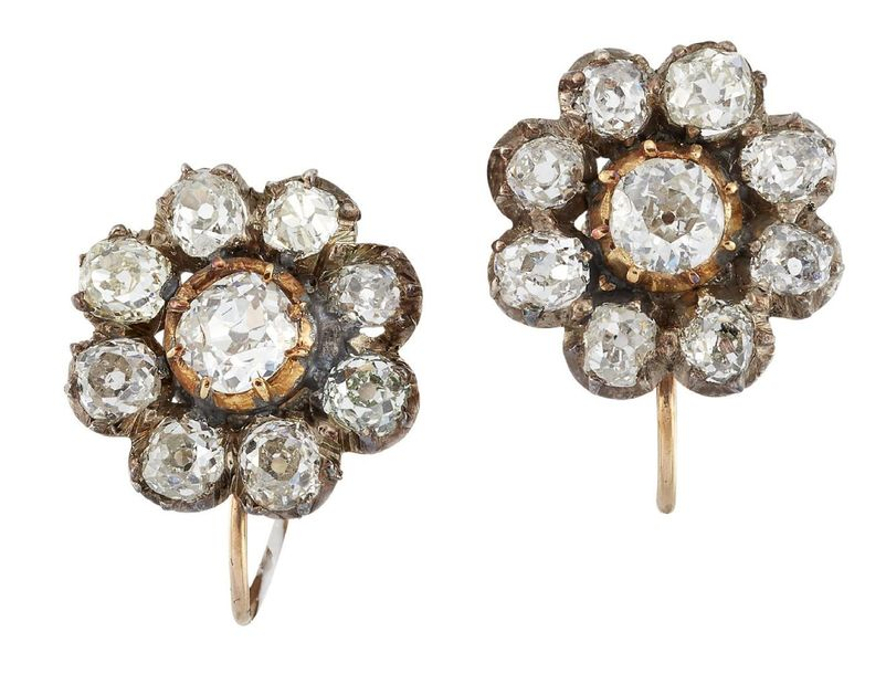 A pair of 19th century gold and silver mounted diamond cluster earrings, each of…