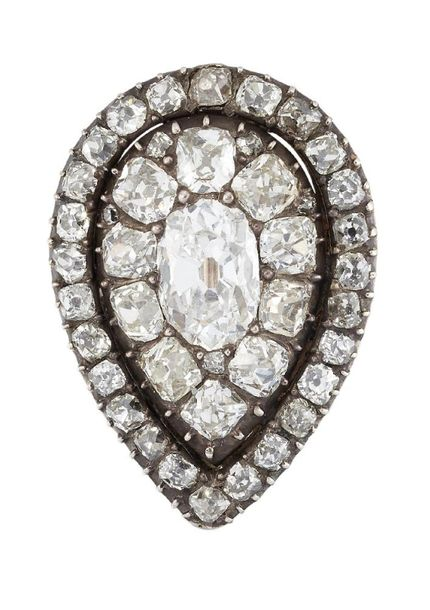 An early 19th century diamond set brooch, of pendeloque cluster form, centrally …