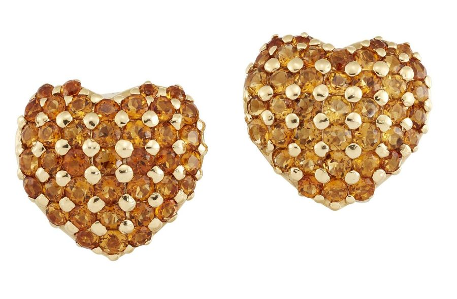 A pair of citrine heart earrings, of rounded heart form, each designed as a latt…