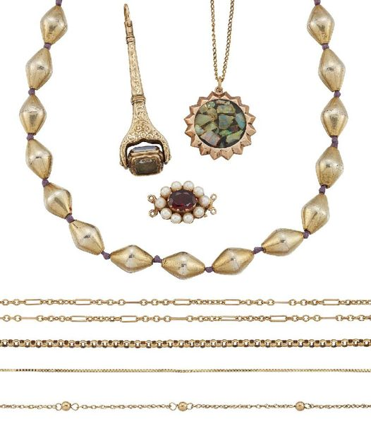 A group of jewellery, comprising: a 9ct gold, seed pearl and garnet clasp, Birmi…