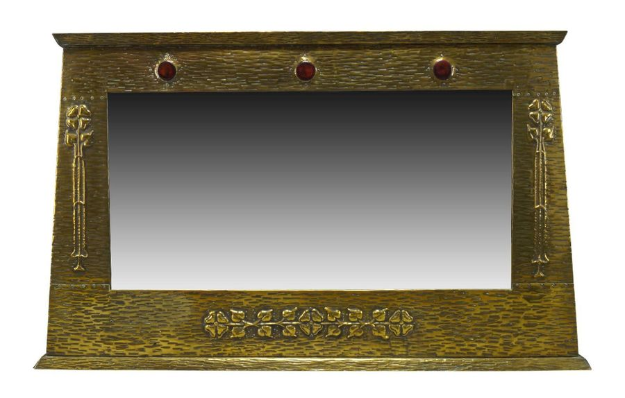An Arts and Crafts brass framed over mantel mirror with ceramic insets  c.1905  …