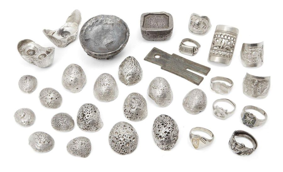 A collection of Chinese silver rings and white metal ingots, 20th century, (29) …