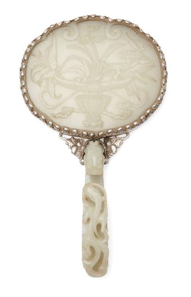 A Chinese greenish white jade plaque and belt hook, 18th century, now mounted to…
