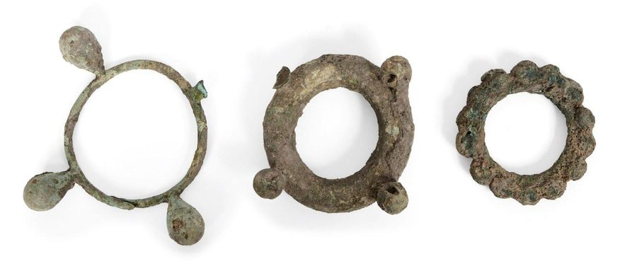Three large Chinese bronze bracelets, Neolithic period, each cast with spherical…