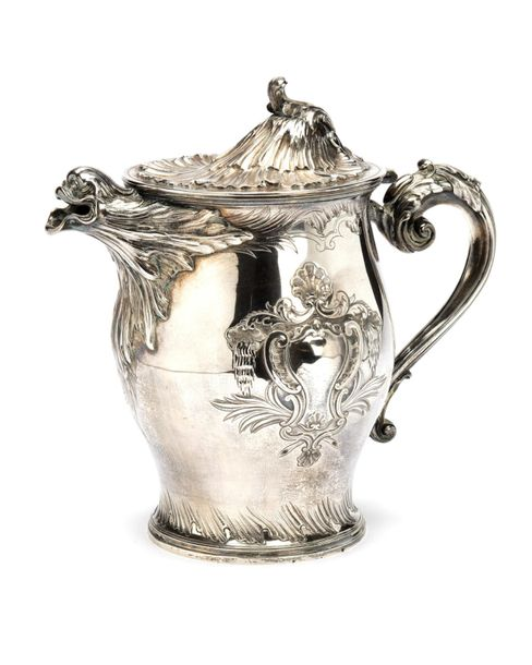 A large Portugese silver ewer A large Portugese silver ewer, Large bulbous and s…