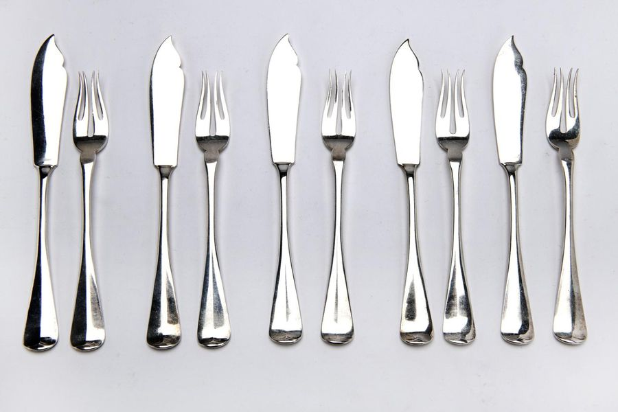 Twelve Dutch silver fish knives and forks Twelve Dutch silver fish knives and fo…