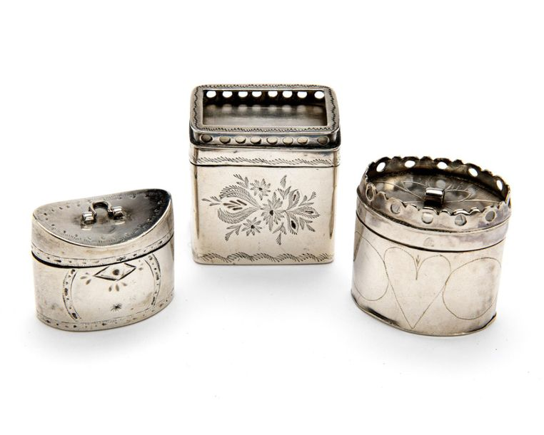 Three Dutch silver scent boxes Three Dutch silver scent boxes, An oval model wit…