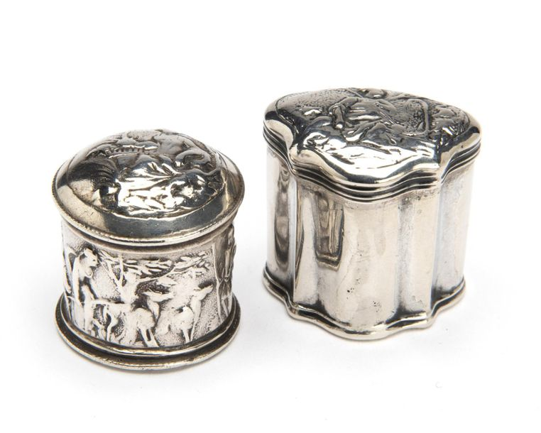 Two Dutch silver scent boxes Two Dutch silver scent boxes, A round box, richly d…