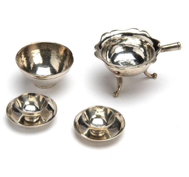 A Dutch silver miniature bowl, two cups and saucers and a brazier without handle…