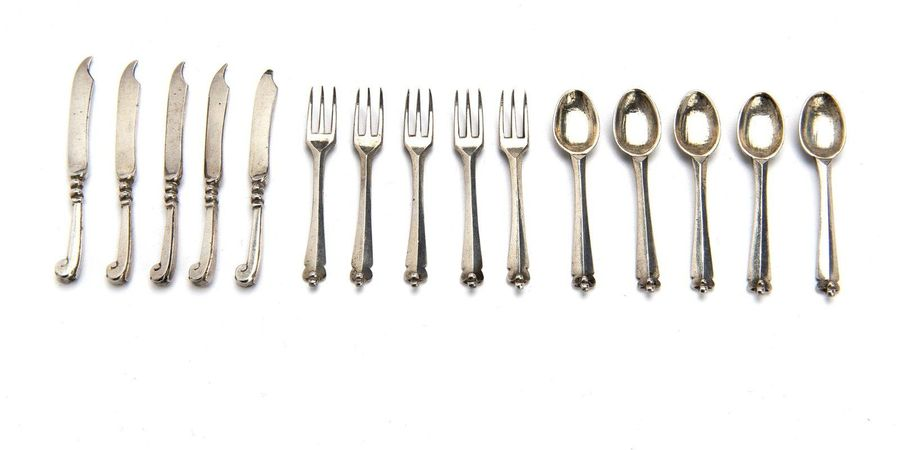 Five miniature silver spoons, forks and knives Five miniature silver spoons, for…