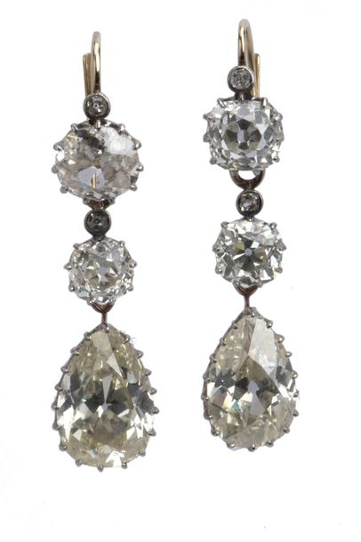 A pair of antique diamond earrings A pair of antique diamond earrings, Each set …