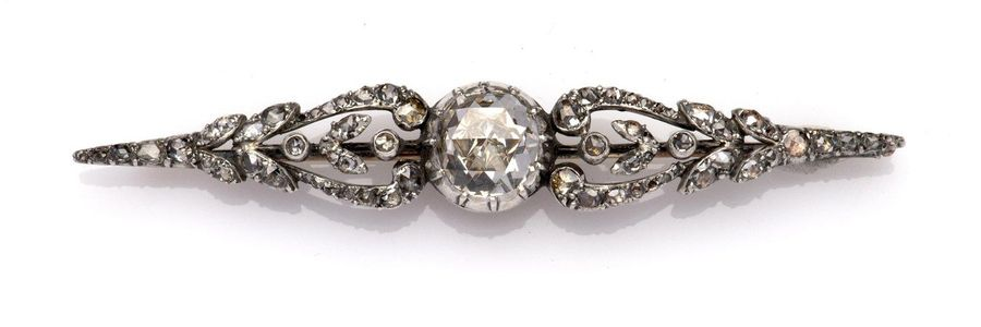 A 14k gold and silver diamond brooch A 14k gold and silver diamond brooch, The b…