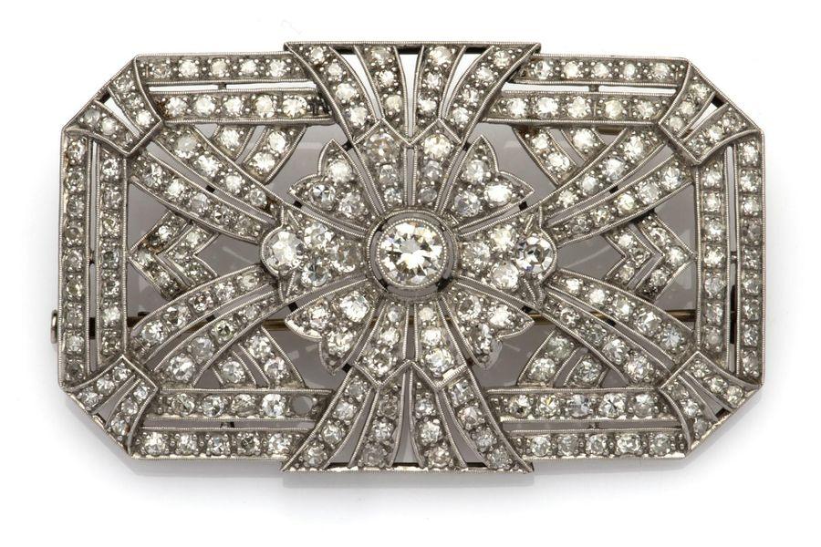 An Art Deco diamond brooch An Art Deco diamond brooch, The pierced octagonal bro…