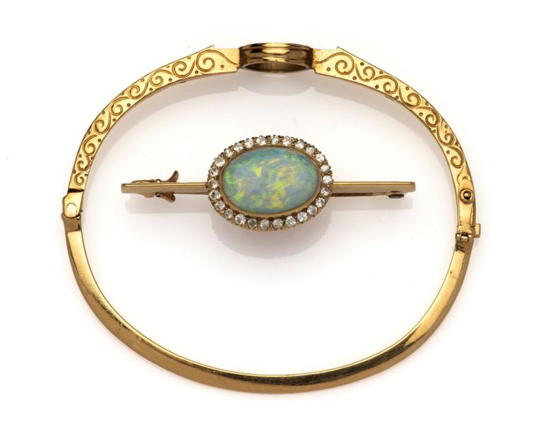 An antique 18k gold opal and diamond jewel An antique 18k gold opal and diamond …