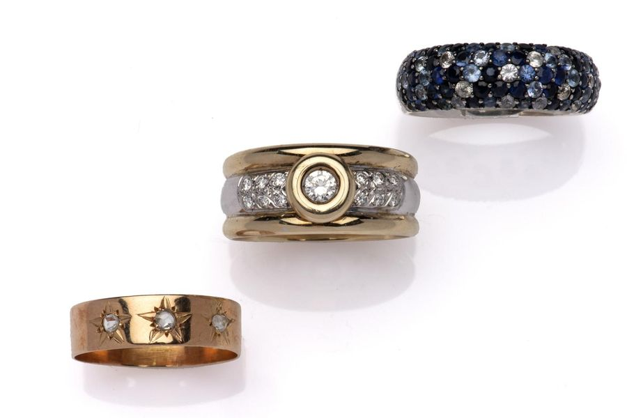 Three rings Three rings, One designed as a two colour 14k gold band set with bri…