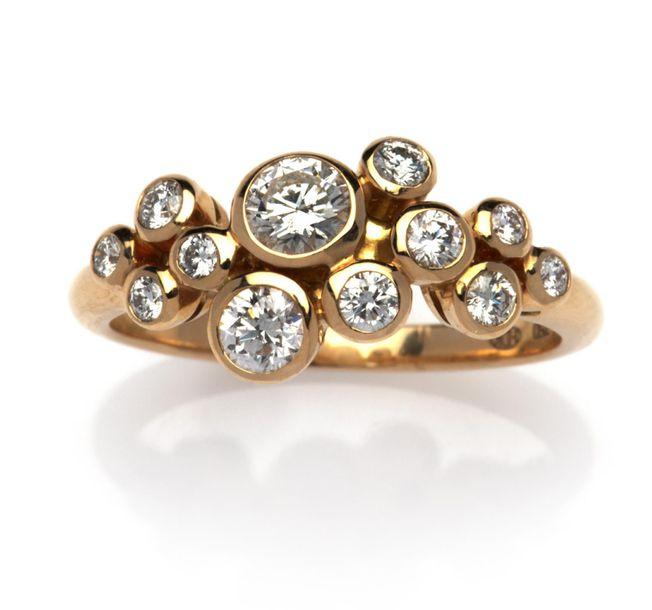 An 18k gold diamond ring An 18k gold diamond ring, The front set with a cluster …