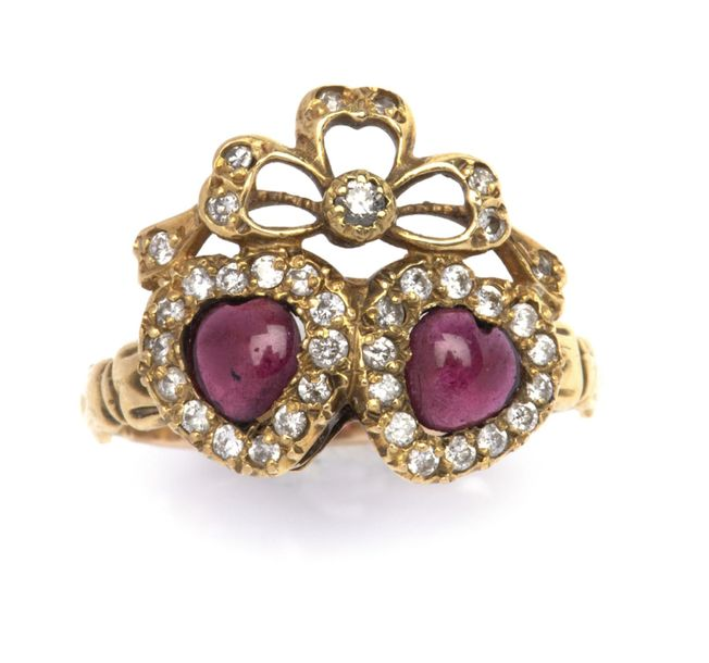A ruby and diamond ring A ruby and diamond ring, Designed as two hearts set with…