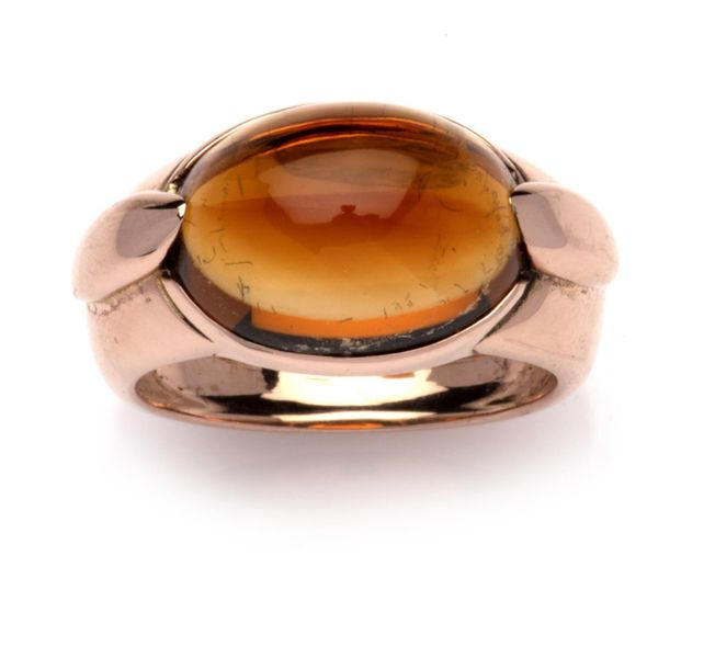 A 14k pink gold citrine ring A 14k pink gold citrine ring, The front set with a …