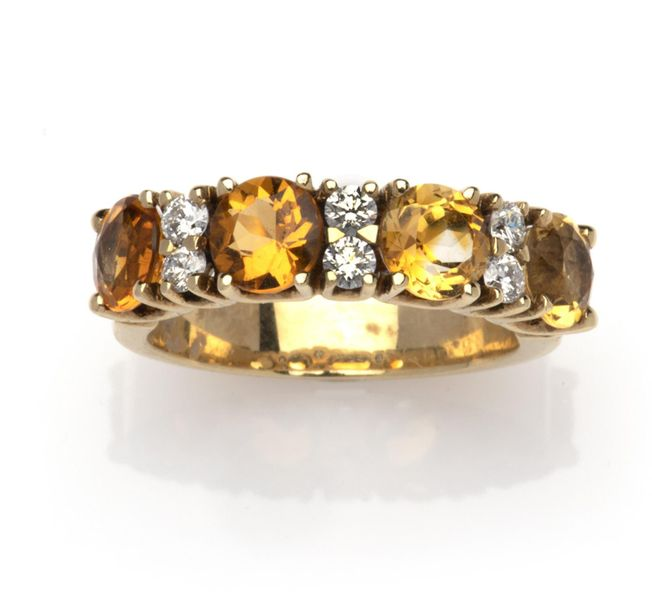 A 14k gold citrine and diamond ring A 14k gold citrine and diamond ring, Set wit…