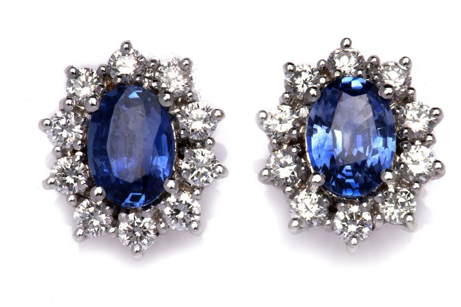 A pair of 18k white gold sapphire and diamond earrings A pair of 18k white gold …