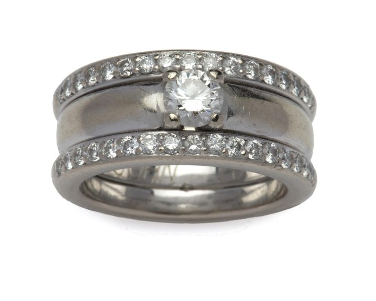 A 14k white gold diamond ring A 14k white gold diamond ring, Composed of two dia…