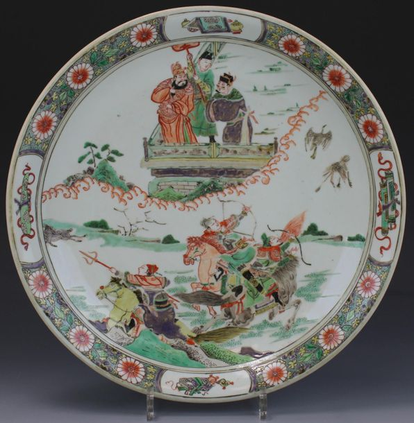 A famille verte charger with a hunting scene A famille verte charger with a hunt…