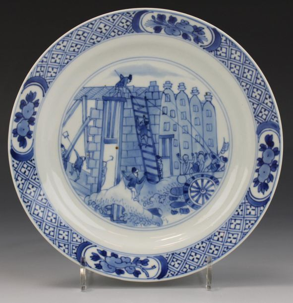 "A blue and white plate depicting the ""Rotterdam Riots"" A blue and white plate de…"