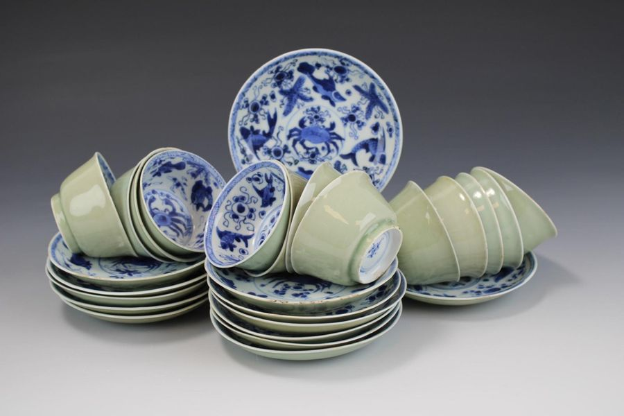 Thirteen blue and white cups and saucers with celadon glaze Thirteen blue and wh…