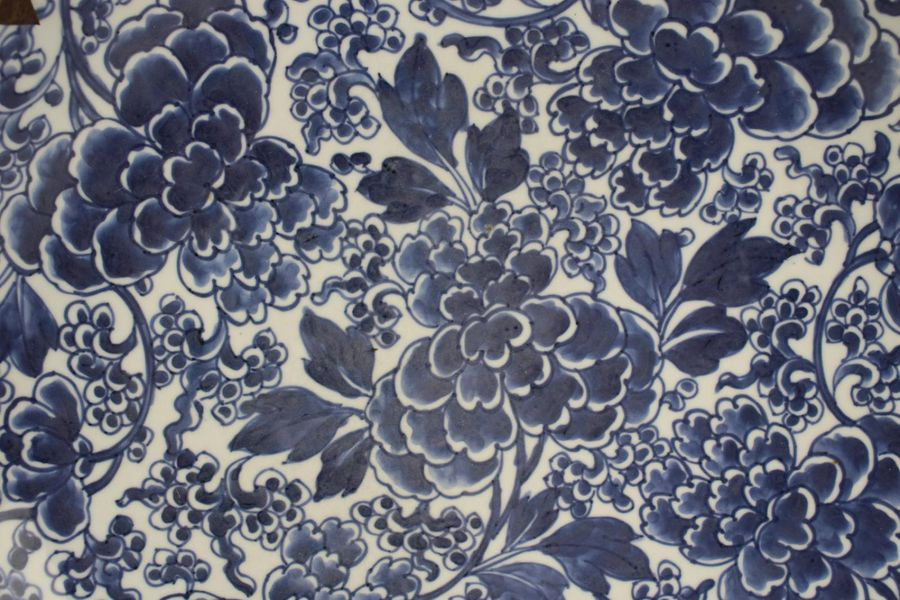 A large wall charger blue and white peony pattern A large wall charger blue and …