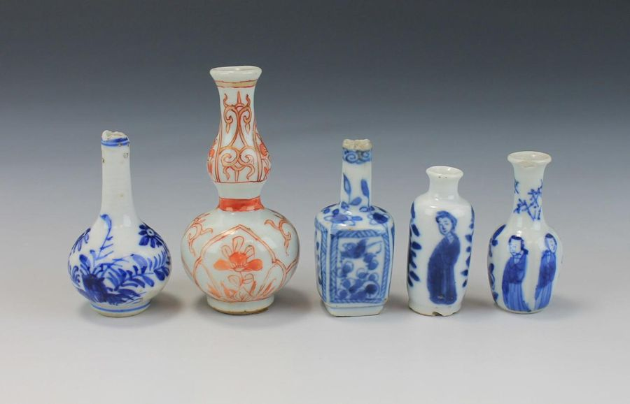 A collection of nine miniature or dolls house vases A collection of nine miniatu…