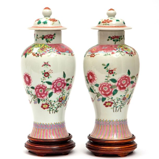A pair of famille rose floral lidded vases A pair of famille rose floral lidded …