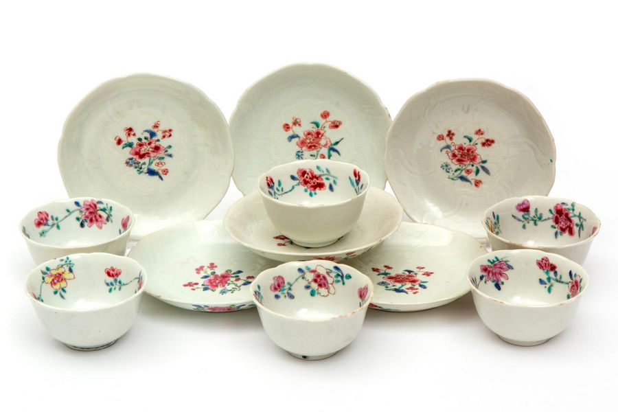 Six famille rose flower shaped cups and saucers Six famille rose flower shaped c…