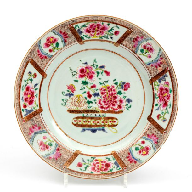 A famille rose flower basket plate A famille rose flower basket plate, 18th cent…