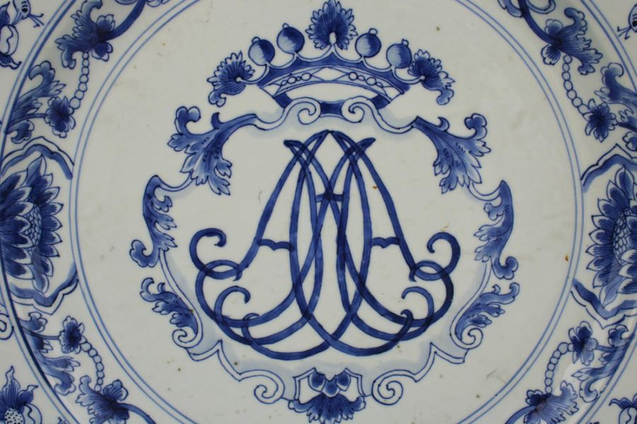 A large blue and white charger with crowned monogram A large blue and white char…