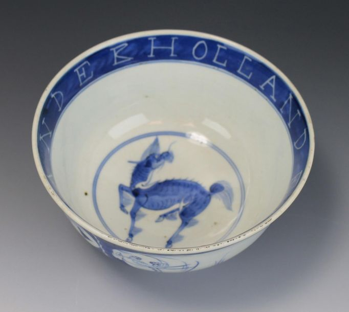 A Japanese blue and white porcelain bowl with Dutchmen and elephants A Japanese …