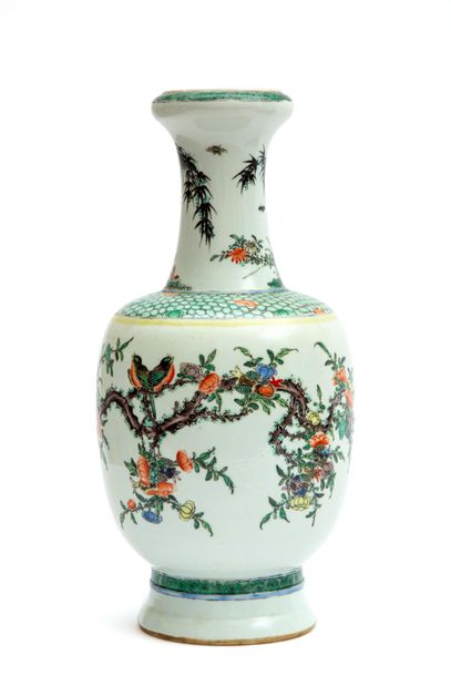A famille verte vase decorated with birds and florals A famille verte vase decor…