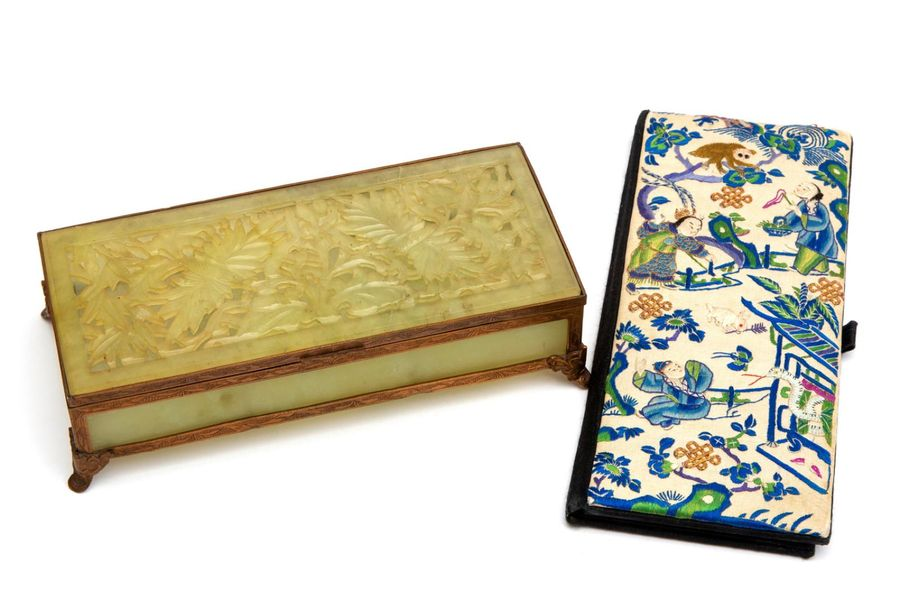 A carved jade box and an embroidered case A carved jade box and an embroidered c…