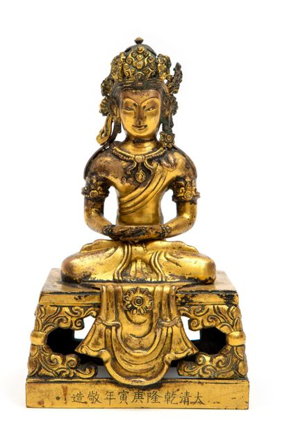 A Chinese gilded bronze figure of Amitayus A Chinese gilded bronze figure of Ami…