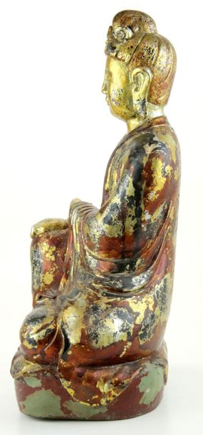 A Chinese polychrome and gilt wood Guanyin A Chinese polychrome and gilt wood Gu…