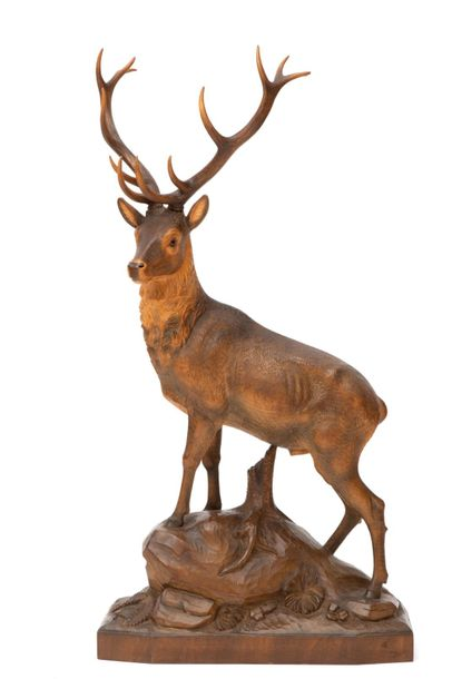 A carved wooden sculpture of a stag A carved wooden sculpture of a stag, 20th ce…